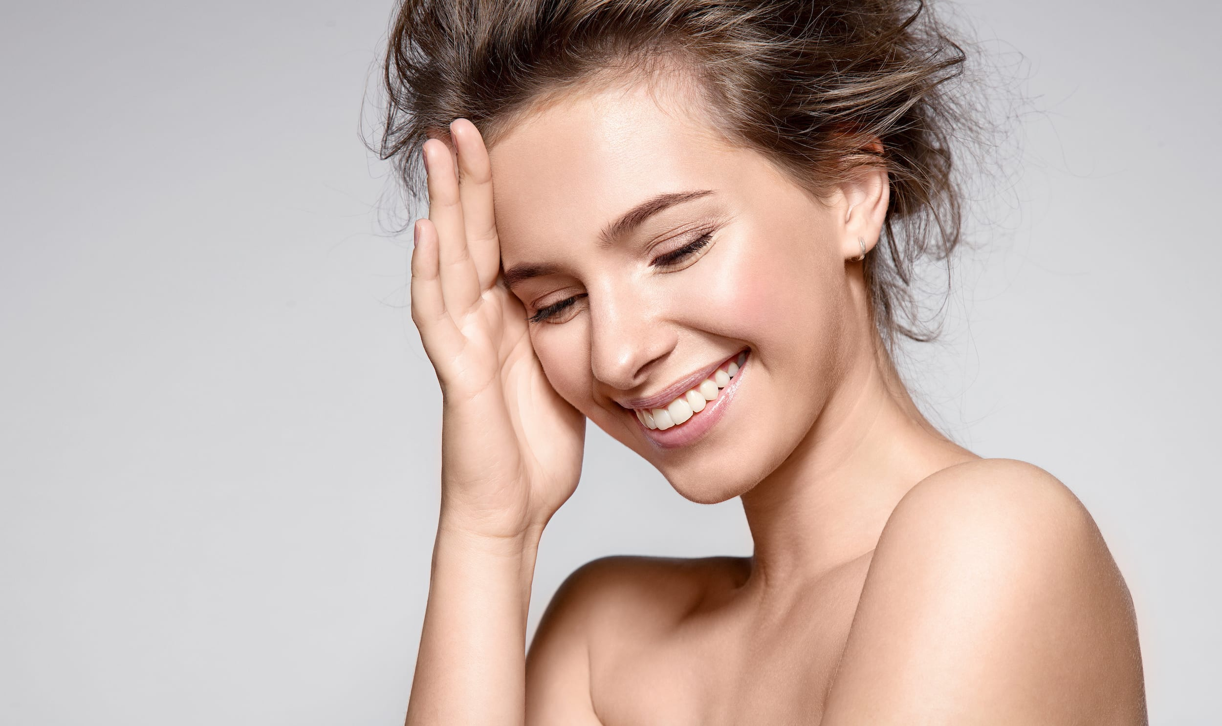 Beautiful smiling woman with natural make-up ready to see Plastic Surgeon in Winnipeg, MB