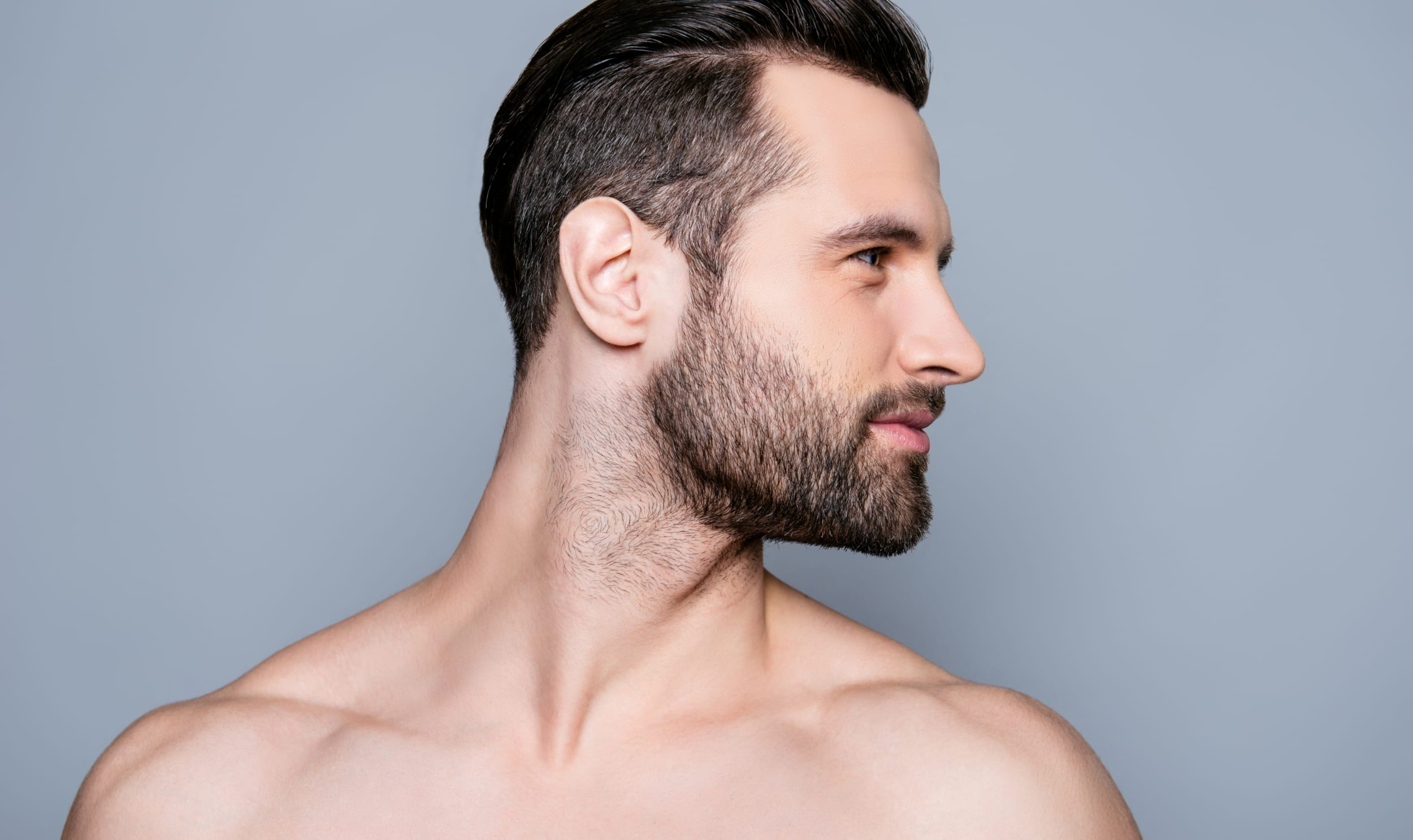 Portrait of handsome young muscular sexy bearded man ready for Plastic Surgeon in Winnipeg, MB